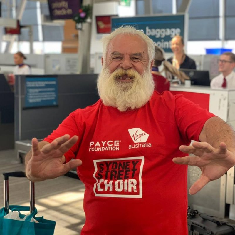 Sydney Street Choir member is his bright red t-shirt